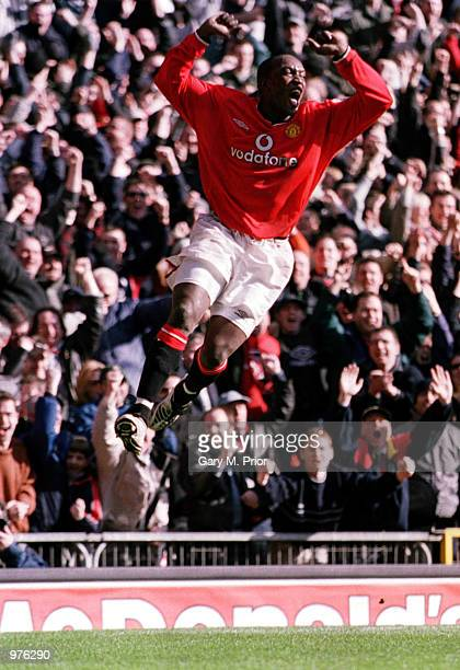 Dwight Yorke of Man Utd celebrates after scoring his second goal during the FA Carling Premiership match between Manchester United and Arsenal played...