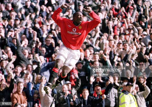 Dwight Yorke of Man Utd celebrates after scoring the second goal during the Manchester United v Arsenal FA Carling Premiership match at Old Trafford...