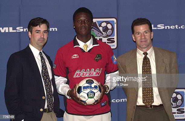 Edward Johnson poses with Dallas Burn general manager Andy Swift and coach Mike Jeffries during the Major League Soccer Super Draft at the Signature...