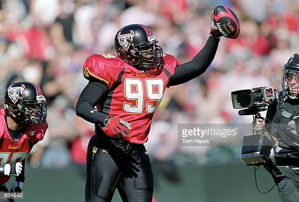 Eric England of the San Francisco Demons celebrates with the ball during the game against the Los Angeles Extreme at Pac Bell Stadium in San...