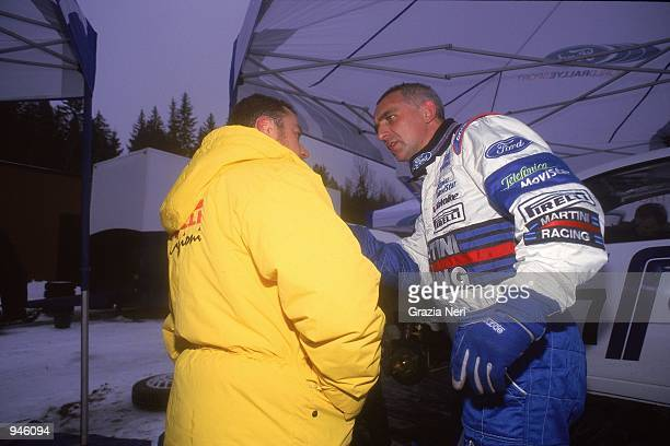 Francois Delecour of France driving the Ford Focus with a Pirelli Tyre Technician during the World Rally Championship Swedish Rally around Karlstad...