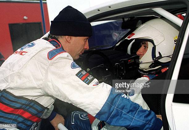 Francois Delecour of team Peugeot speaks with team mate Carlos Sainz during the World Rally Championships in Sweden Germano Gritti / Grazia Neri...