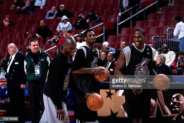 Gary Payton of the Seattle SuperSonics Kobe Bryant of the Los Angeles Lakers and Elton Brand of the Los Angeles Clippers during practice before the...