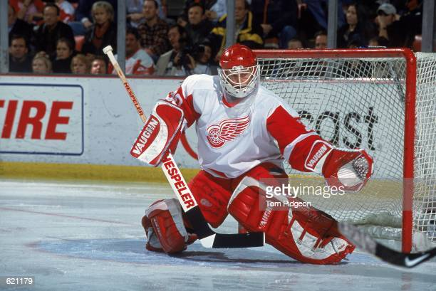 Goal Keeper Chris Osgood of the Detroit Red Wings moves to stop a shot to the goal during the game against the Ottawa Senators at the Joe Louis Arena...