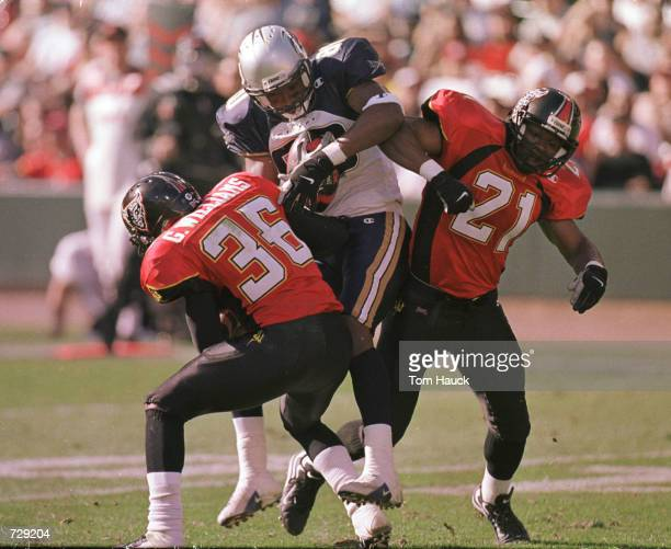 Greg Williams and Wendell Davis o#21 of the San Francisco Demons can''t stop Darnell McDonald of the Los Angeles Xtreme from scoring a touchdown...