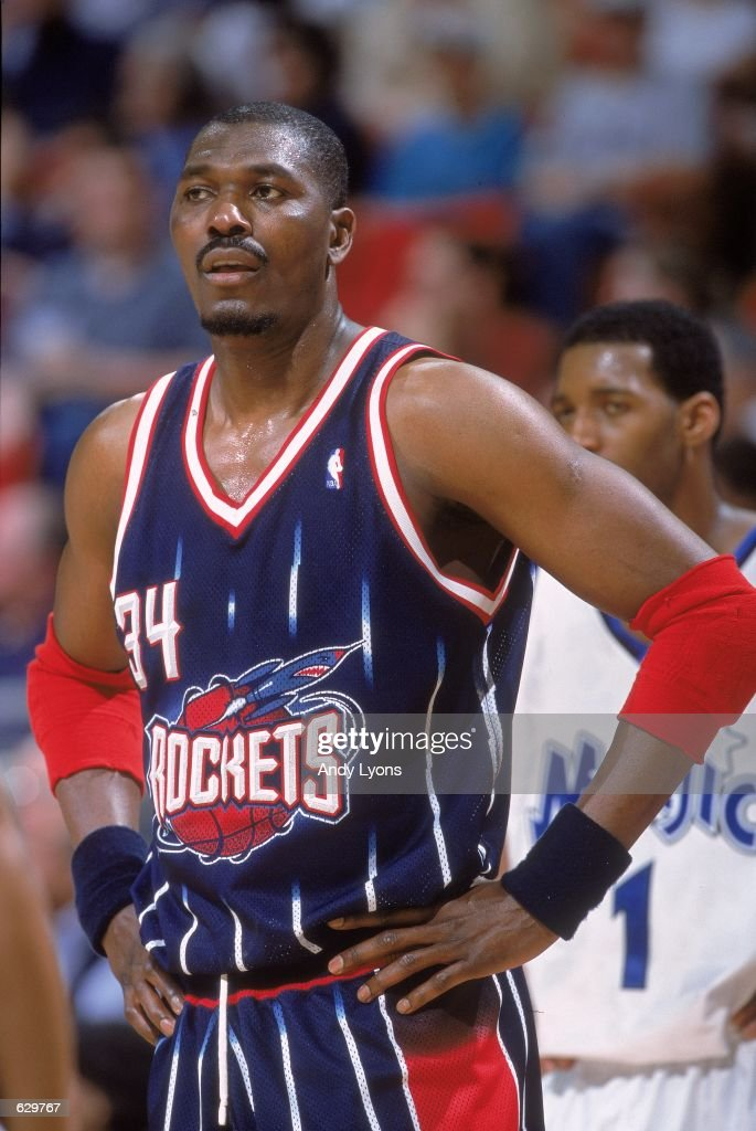 Hakeem Olajuwon #34 of the Houston Rockets stands on the court during the game against the Orlando Magic at the Compaq Center in Houston, Texas. The Magic defeated the Rockets 108-93.