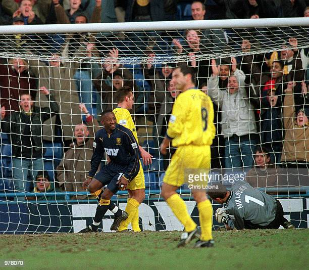 Jason Euell of Wimbledon turns to celebrate after scoring during the Nationwide Division One match between Wimbledon and Queens Park Rangers at...