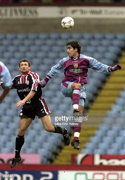 Juan Pablo Angel of Aston Villa wins the header against Gianluca Festa of Middlesbrough during the FA Carling Premiership match played at Villa Park...