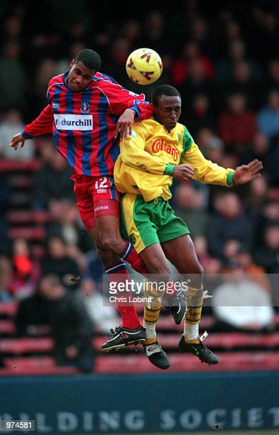 Julian Gray of Palace and Darren Kenton of Norwich both jumps for a header during the Nationwide League Division One match between Crystal Palace and...