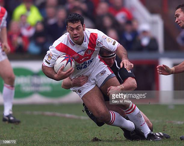 Kevin Iro of St Helens is tackled by David Furner of Wigan during the Fourth Round of the Silk Cut Challenge Cup between St Helens v Wigan at...