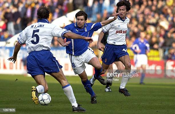 Lanna and Jose Igancio of Real Zaragoza and De tomic of Real Oviedo in action during the Primera Liga game between Real Zaragoza and Real Oviedo La...