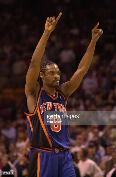 Latrell Sprewell of the New York Knicks celebrates with the Knicks ahead 101100 with 37 seconds left in overtime against the Miami Heat at the...