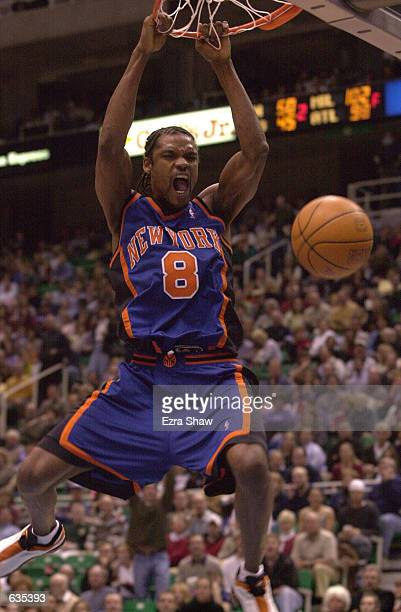 Latrell Sprewell of the New York Knicks goes up for a dunk during their game against the Utah Jazz at the Delta Center in Salt Lake City Utah DIGITAL...