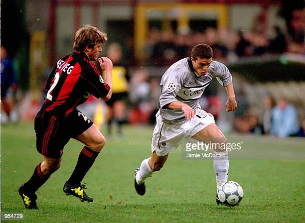 Laurent Robert of Paris St Germain takes the ball past Thomas Helveg of AC Milan during the UEFA Champions League Group B match played at the San...