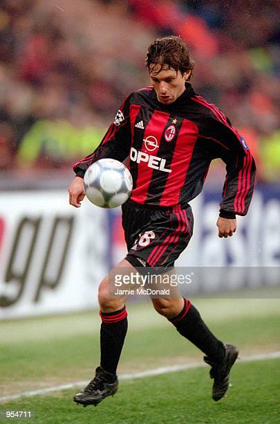 Leonardo of AC Milan runs with the ball during the UEFA Champions League Group B match against Paris St Germain played at the San Siro in Milan Italy...