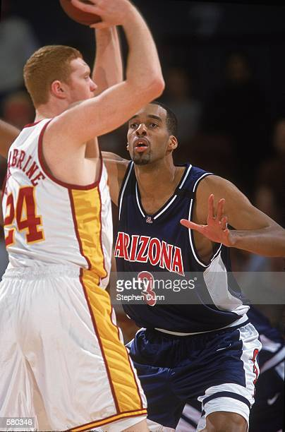 Loren Woods of the Arizona Wildcats guards Brian Sculabrine of the University of Southern California Trojans during the game at the Los Angeles...