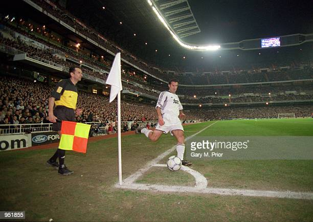 Luis Figo of Real Madrid takes a corner kick during the UEFA Champions League Group D match against Lazio played at the Santiago Bernabeau in Madrid...