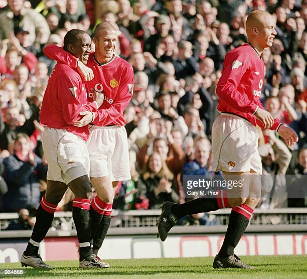 Manchester United players celebrate a goal during the FA Carling Premier League match between Manchester United and Arsenal at Old Trafford...
