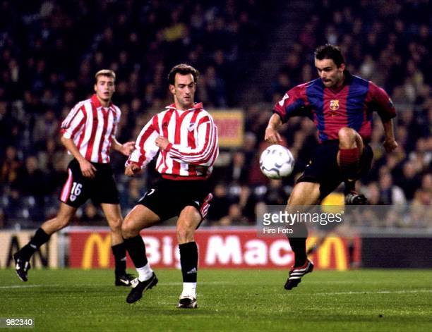 Marc Overmars of Barcelona clears the ball from Exteberria of Bilbao during the game between Barcelona v Bilbao in the Primera Liga played at the Nou...