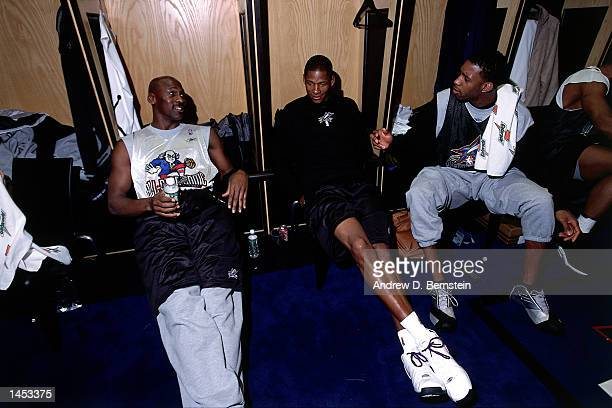 Michael Jordan of the Washington Wizards Ray Allen of the Milwaukee Bucks and Tracy McGrady of the Orlando Magic in the locker room before the 2002...