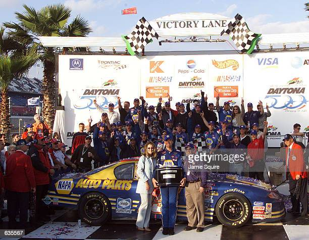 Michael Waltrip celebrates with his team after winning the NASCAR Winston Cup Daytona 500 at the Daytona International Speedway in Daytona Beach...