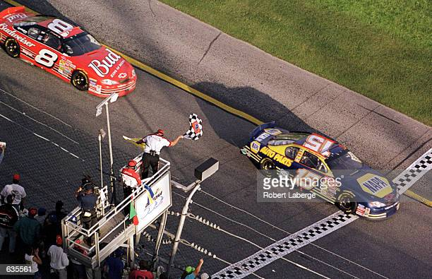 Michael Waltrip in the NAPA Chevrolet takes the checkered flag en route to winning the NASCAR Winston Cup Daytona 500 at the Daytona International...