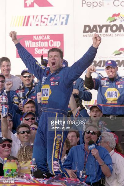 Michael Waltrip who drives a Chevy Monte Carlo for Dale Earnhardt Inc celebrates his victory after the Daytona 500 Speedweeks part of the NASCAR...