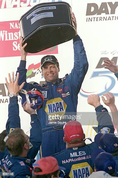 Michael Waltrip who drives a Chevy Monte Carlo for Dale Earnhardt Inc holds the trophy after the Daytona 500 Speedweeks part of the NASCAR Winston...