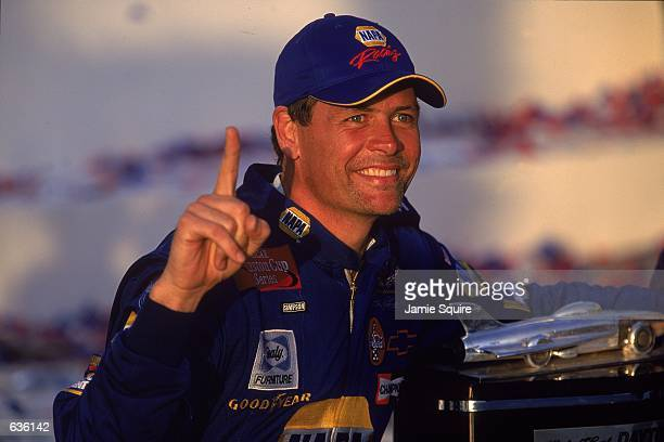 Michael Waltrip who drives the Chevy Monte Carlo for Dale Earnhardt Inc celebrates his victory after the Daytona 500 Speedweeks part of the NASCAR...