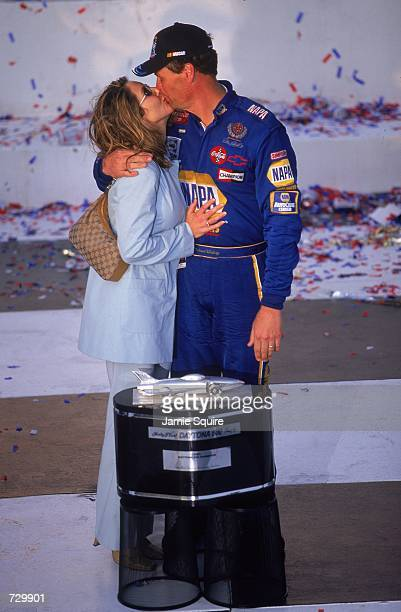 Michael Waltrip who drives the Chevy Monte Carlo for Dale Earnhardt Incpulls his wife Buffy closer and kisses her to celebrate his victory after the...