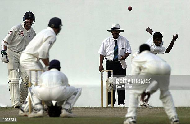 Muttiah Muralitharan of Sri Lanka bowls to Mike Atherton of England during the 2nd day of the 1st Test between Sri Lanka and England at the Galle...