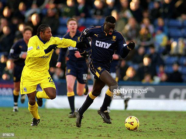 Patrick Agyemang of Wimbledon gets away from Jermaine Darlignton of QPR during the Nationwide Division One match between Wimbledon and Queens Park...