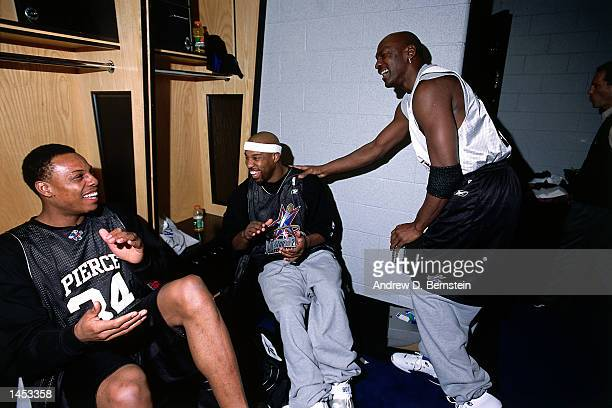 Paul Pierce of the Boston Celtics Baron Davis of the Charlotte Hornets and Michael Jordan of the Washington Wizards during practice before the 2002...