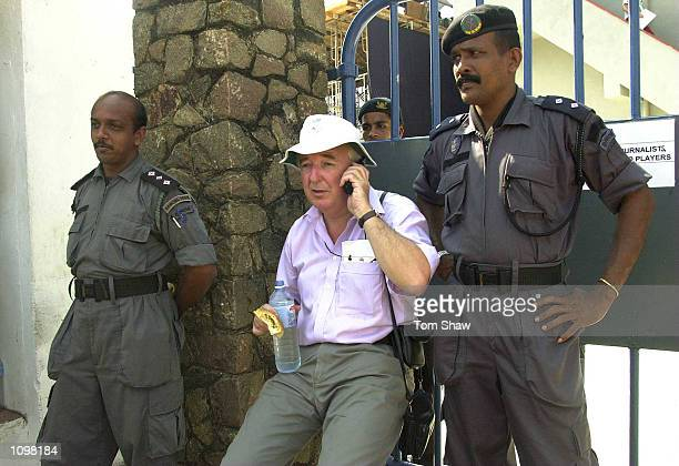 Peter Baxter the producer of the BBC radio cricket coverage is watched over by guards as he waits all day at the gates after the BBC were kept out of...