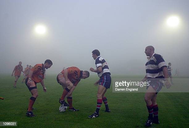 Players from Toowoomba and the Easts Coast Tigers try to find there way thru the fog before the NRL trial game between the Brisbane Broncos and the...