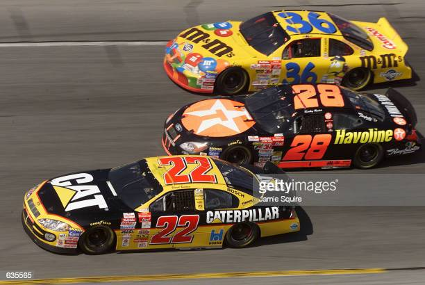 Ricky Rudd in the TexacoHavoline Ford is sandwiched between the Bill Davis Racing Dodge Intrepid of Ward Burton and the MMs Pontiac of Kenny...