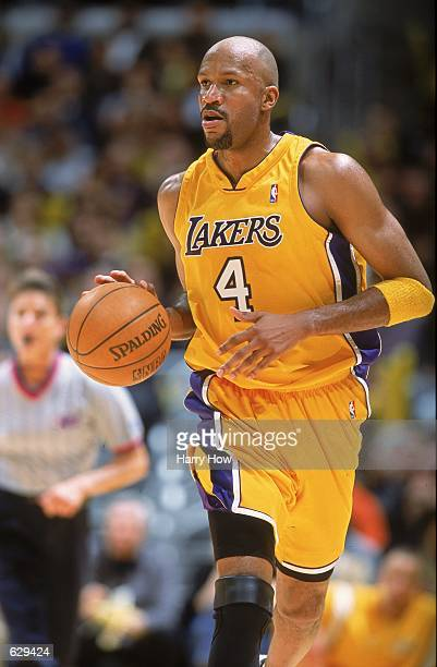 Ron Harper of the Los Angeles Lakers dribbles the ball down the court during the game against the Phoenix Sun at the STAPLES Center in Los Angeles...