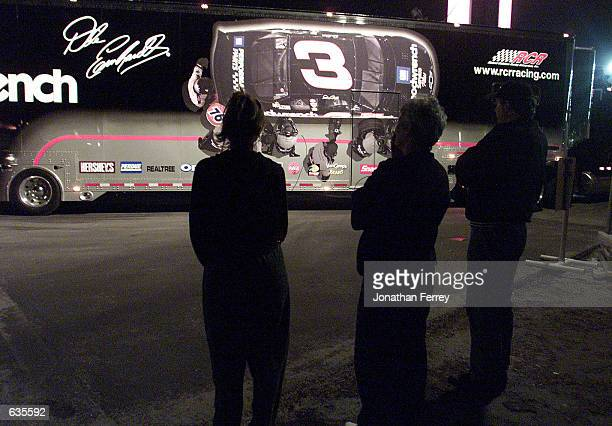 Saddened fans watch the departure of Dale Earnhardt's car hauler as it leaves the track Dale Earnhardt later succumbed to the injuries he recieved in...