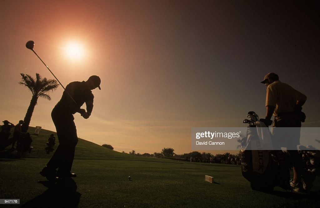 Silhouette of Tiger Woods of the USA in action during a practice round before the Dubai Desert Classic at the Emirates GC in Dubai. \ Mandatory Credit: David Cannon /Allsport