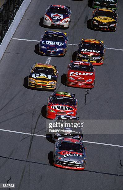 Sterling Marlin who drives a Dodge Intrepid for Chip Ganassi Racing is in front of Dale Earnhardt during the Daytona 500 Speedweeks part of the...