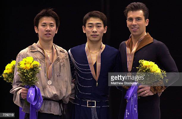 Takeshi Honda of Japan Chengjiang Li of China and Michael Weiss pose on the winner's podium after the free skate portion during the Four Continents...