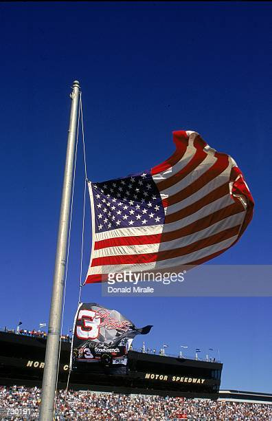 The American flag and the number 3 Flag is raised halk staff in tribute to Dale Earnhardt during the Dura Lube 400 part of the Winston Cup Series at...
