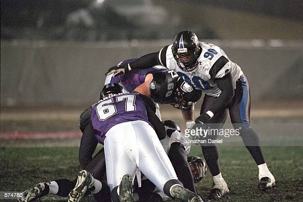 Tim Beauchamp of the New York/New Jersey Hitmen moves to block as Tony Ramirez of the Chicago Enforcers helps tackle during the game at Soldier Field...