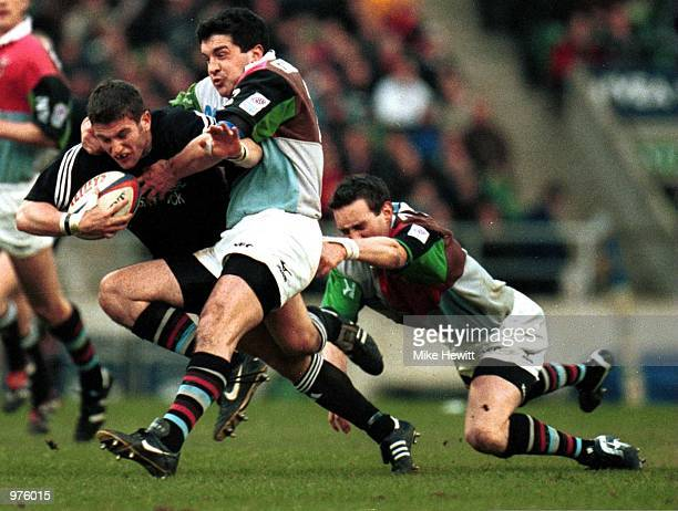 Tom May of Newcastle is stopped by Nick Greenstock and Ryan O''Neill of Quins during the match between NEC Harlequins and Newcastle Falcons in the...