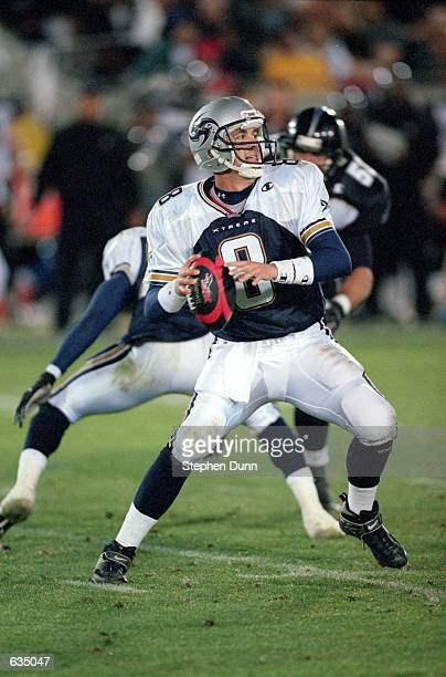 Tommy Maddox of the Los Angeles Xtreme drops back to pass the ball during the game against the Chicago Enforcers at the LA Coliseum in Los Angeles...