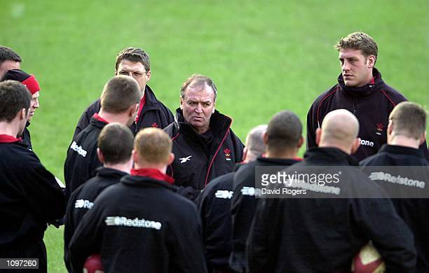 Wales Coach Graham Henry talks with his players during a training session before Saturday's Six Nations Rugby Union match against Scotland at...
