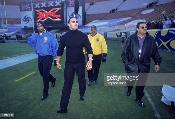 WWF's The Rock walks out to greet the fans before the game between the Los Angeles Xtreme and the Chicago Enforcers at the LA Coliseum in Los Angeles...