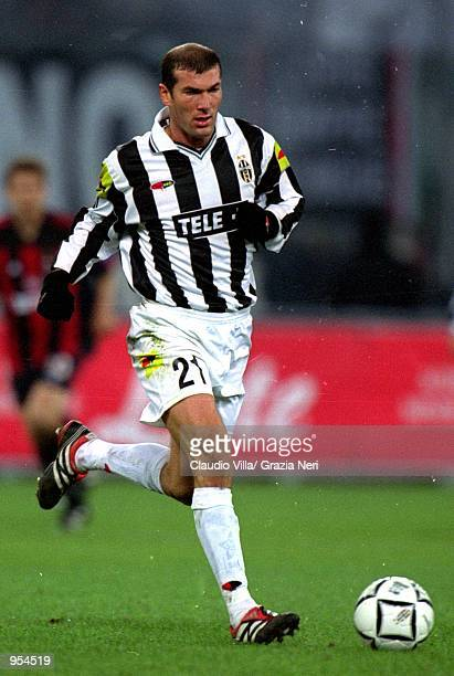 Zinedine Zidane of Juventus in action during the Serie A match against AC Milan at the Stadio Delle Alpi in Turin Italy Mandatory Credit Claudio...