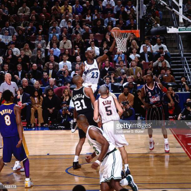 Michael Jordan of the Washington Wizards drives to the basket against Tim Duncan of the San Antonio Spurs during the 2002 NBA All Star Game at the...