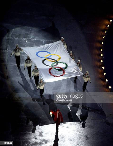 Year old Ryne Sanborn the Child of Light leads the IOC Flag out of the Stadium during the Closing Ceremony of the Salt Lake City Winter Olympic Games...